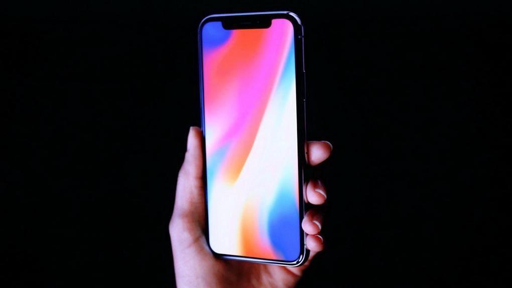 iPhone X-смартфон в руках
