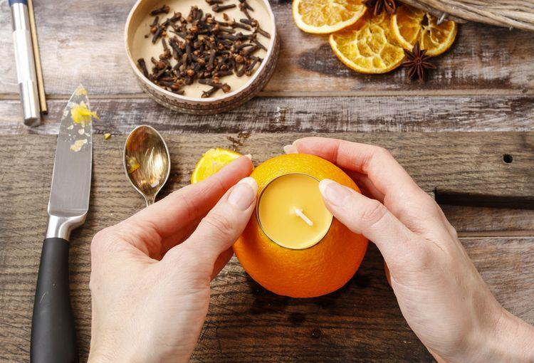Подсвечники из апельсинов-фото