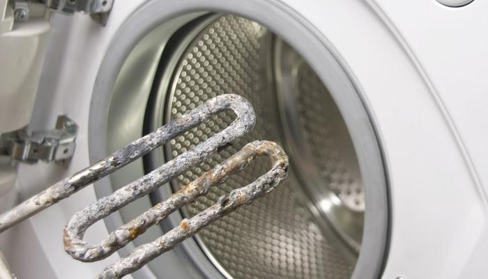 Неприятный запах в стиральной машине_лучшие способы избавления - Нагревательный элемент с накипью