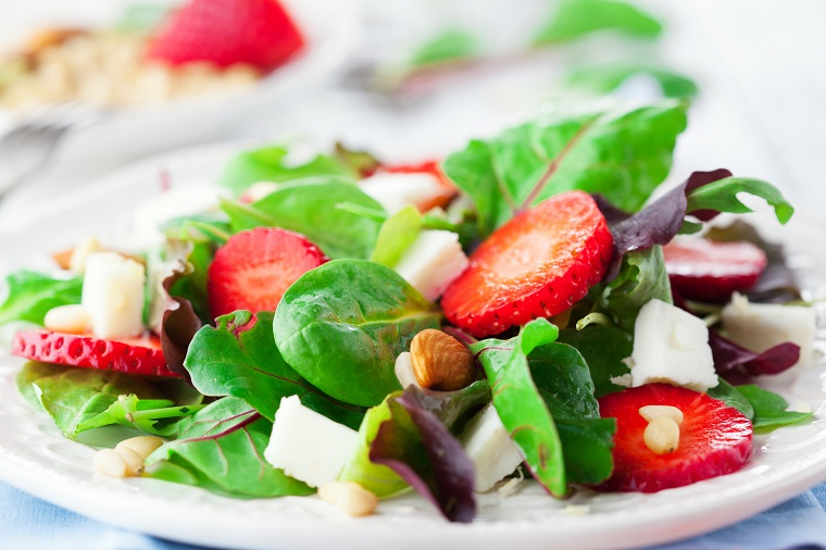 Spring salad with spinach leaves