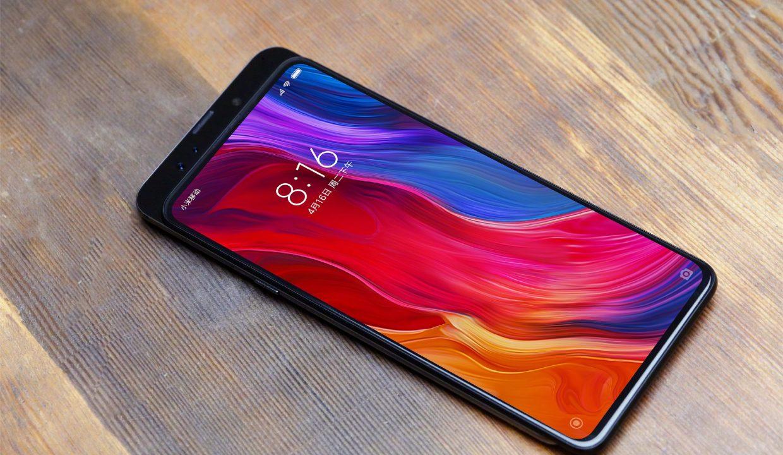 Слайдер нового поколения_ Xiaomi Mi Mix 3 - смартфон на столе