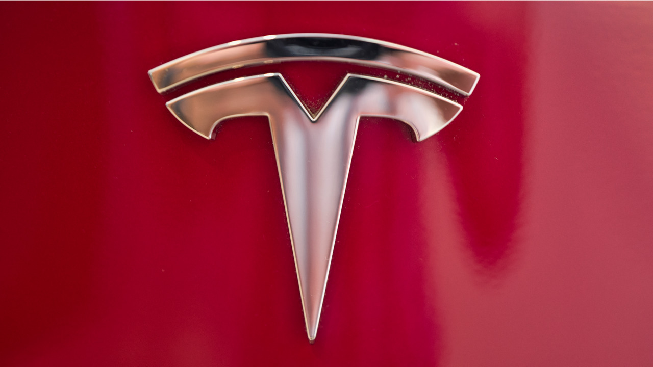 Что означает логотип Tesla 2